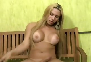Blonde Latina shegirl unveils breasts and huge butt in thong
