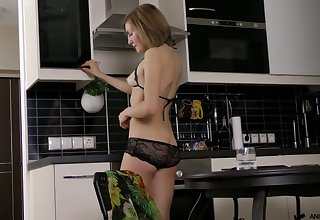 Beautiful housewife Judith Angel is masturbating her pussy on along to scullery table