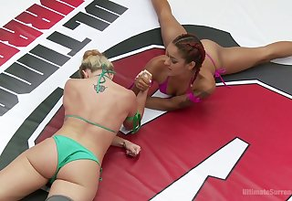 Savannah Fox puts on strapon and fucks ebony rival right in the ring