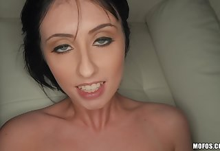 Dark-haired chick lies down to get enveloping holes satisfied
